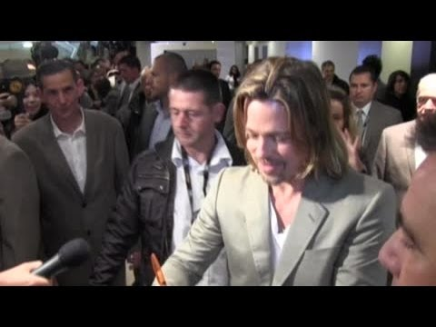 Brad Pitt shows he's a Saint for charity - Splash News | Splash News TV | Splash News TV