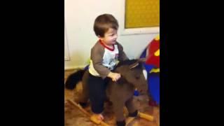 Cash Riding A Rocking Horse