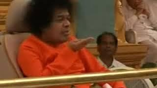 Vibhuti for everyone   Sai Baba materializing Vibhuti blowing it towards devotees and students
