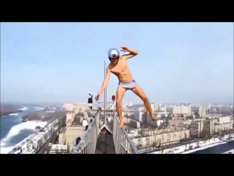 Crazy people walking  on edges tallest buildings