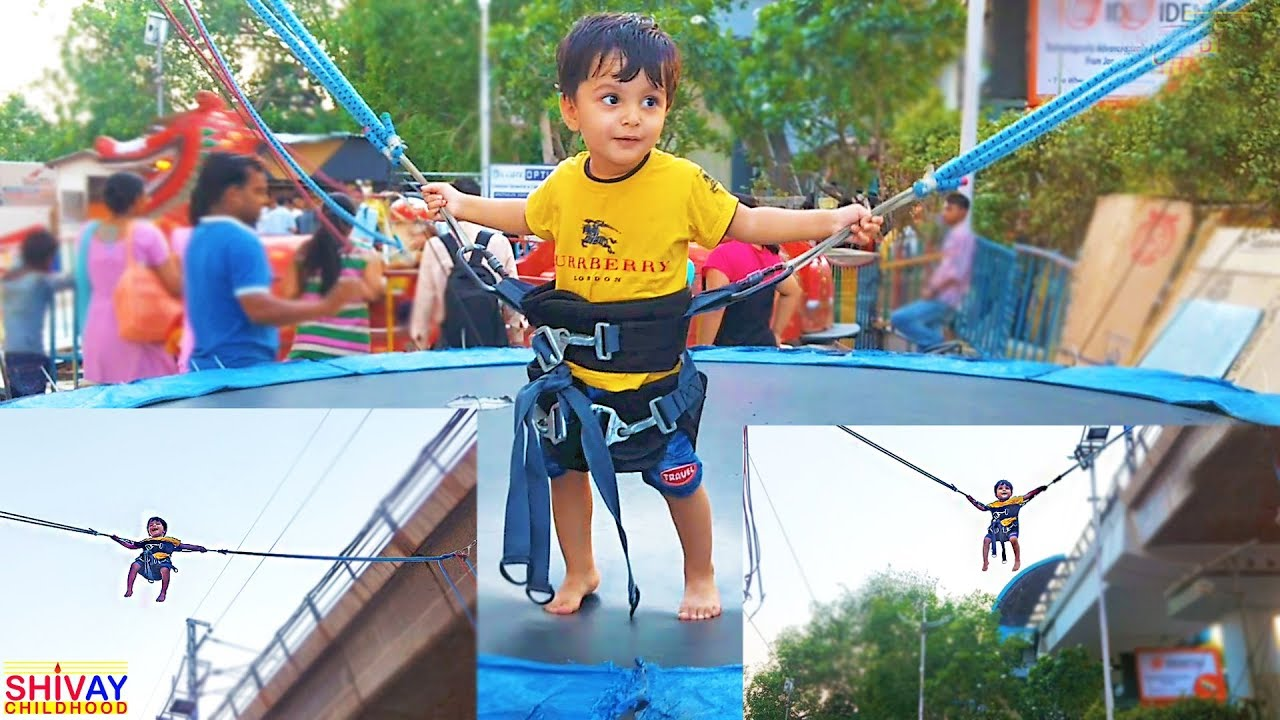 amazing baby bungee jumping trampoline ride like spiderman