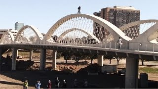 BMX biker rides over Ft. Worth 7th Street Bridge arches