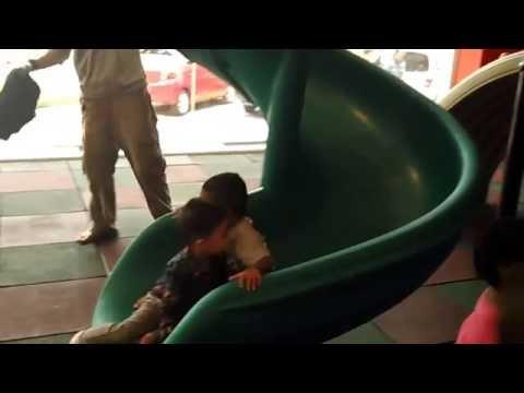 Hanif play swing n' slide