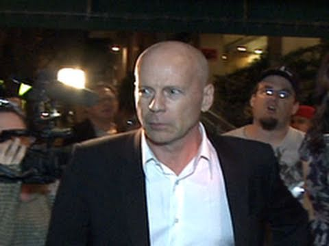 Bruce Willis Leaves Restaurant with Family