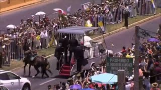Pope breaks protocol and attends to fallen policewoman on horse