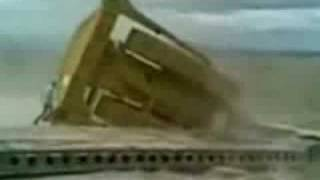 bull dozer falls off semi trailer