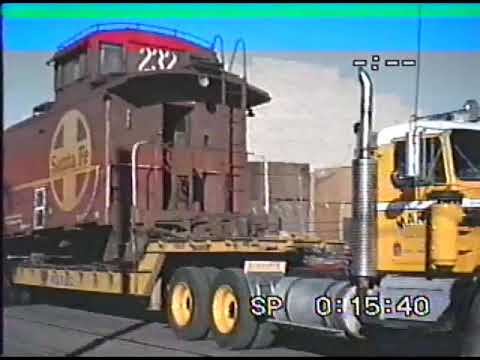Moving a 2-ton Santa Fe caboose over land in Phoenix, 'AZ with truck and crane in 1987...incredible!