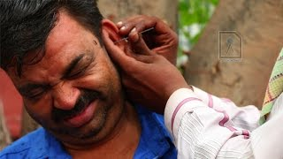 Ear Waxing - Traditional ear cleaner in India