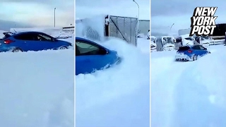 Man uses brand-new Ford Focus to plow through piles of snow