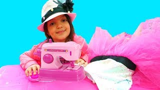 Masal and Mommy playing with Toy Sewing machine / Princess Boutique