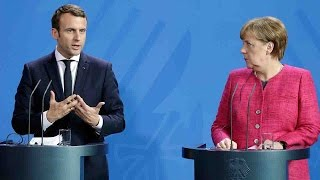 Merkel, Macron talk EU treaty reform as Euro debt looms large