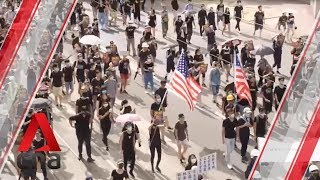 Protesters march in central Hong Kong despite police ban