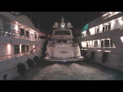 Yacht trying to dock in Monaco at night in very tight gap!