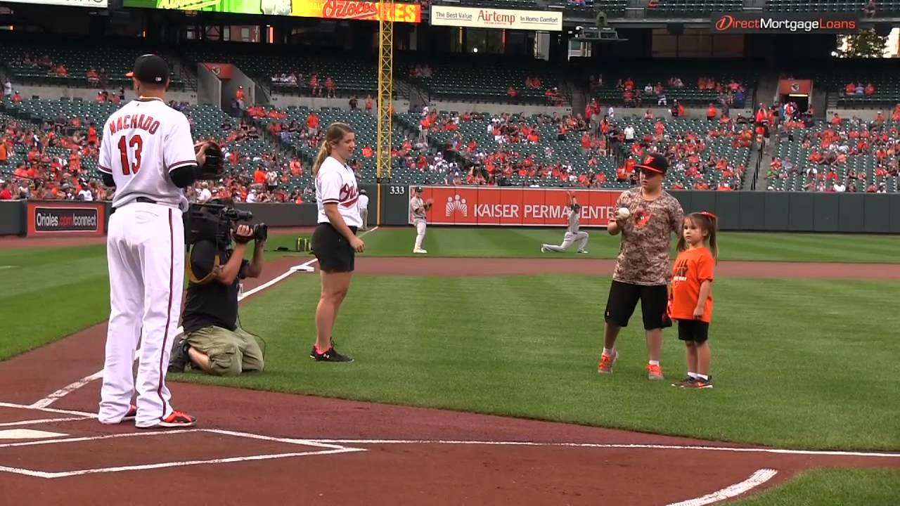 Girl with robot hand throws out amazing first pitch at baseball game