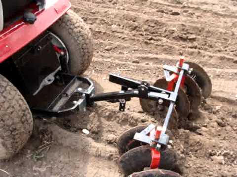 Garden tractor planting potatos with disk harrow YouTube