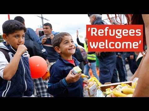 Refugees Cheered Into Germany And Austria