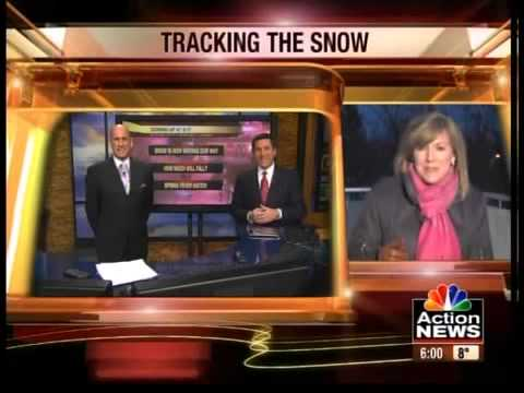 Anchor Elizabeth Alex watches the weather conditions outside