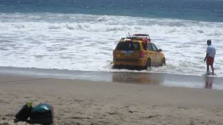 SUV Gets Rescued After Being Taken By A Large Wave At Zuma Beach