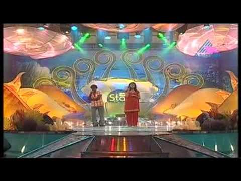 Idea Star singer 2008 Somadas and Amritha .Uruhthe,,,,