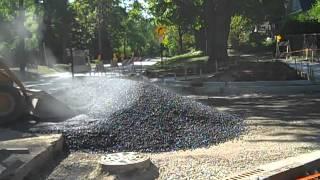 Peter Baker dump truck dumping asphalt