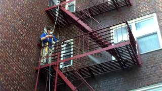 Cleaning bird droppings off a fire escape