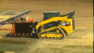 John Deere 333E track loader vs Competition 5500 LB lift