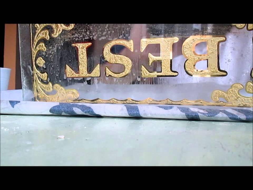 gold leaf lettering on glass