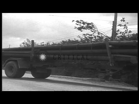 Trucks unload supplies at First Army Signal depot in Normandy, France during Worl...HD Stock Footage