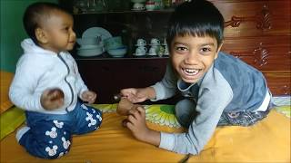 Two kids are playing with wooden toys. Mubin & Mahmud toys review.