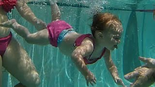 Baby Elizabeth swimming underwater  - ISR Baby swimming across pool
