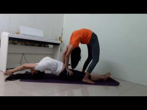 yoga-couple-postures---fish-&-standing-wheel-pose