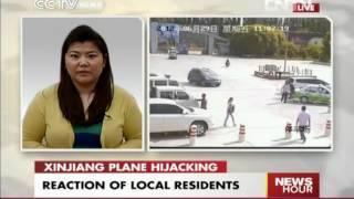 LIVE PHONER HU NAN ON XIJIAN PLANE HIJACKING. China's Sept. 11 foiled, bye passenger