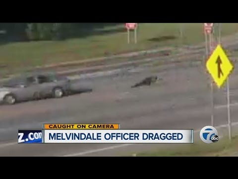 Melvindale Police Officer dragged down the street