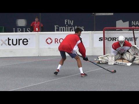 Novak Djokovic trades in his tennis racket for a hockey stick