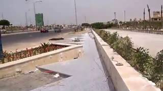 بالصور والفيديو.. تنفيذ أكبر ممشى سياحي بمدينة أكتوبر