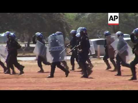 Zimbabwe police beat protesters at legal march