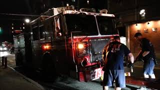 FDNY tow truck towing FDNY engine 273 to take it to the shop