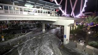 A flash flood flows through the LINQ parking garage and surrounding...
