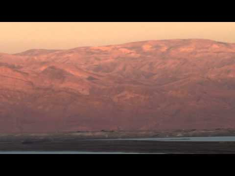 Panning shot of Mountains and the Dead Sea at sunset shot in Israel.