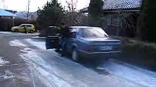 pissed off man punishing car that wont start