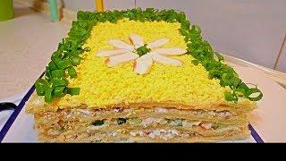 Закусочный торт с начинкой из рыбы и крабовых палочек.