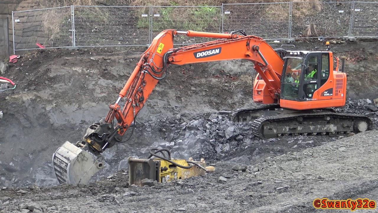 4K| Doosan DX235LCR Excavator Digging Rocks