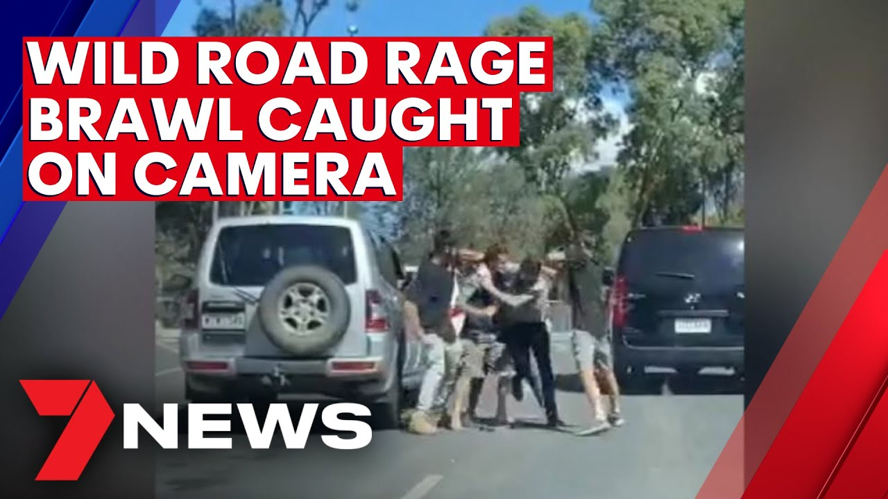 Wild road rage brawl in Adelaide's north caught on camera | 7NEWS