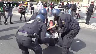 Police scuffle with protesters as parliament debates Covid law changes in Berlin