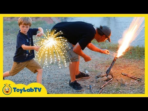 Family Fun Night Playing with Fireworks on 4th of July Lighting Parachute Fireworks & TNT Poppers