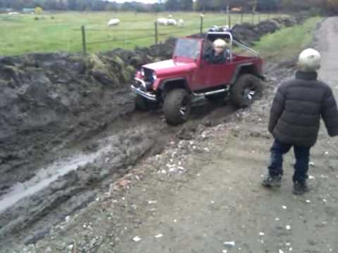 two kids drive a 12 size jeep through mud youtube