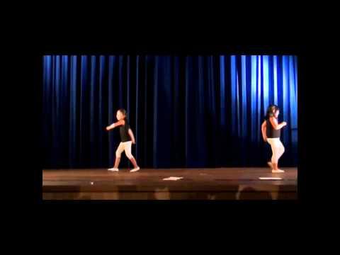2 young girls dancing