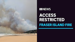 Fraser Island access restricted as bushfire continues, holidaymakers told to stay away | ABC News