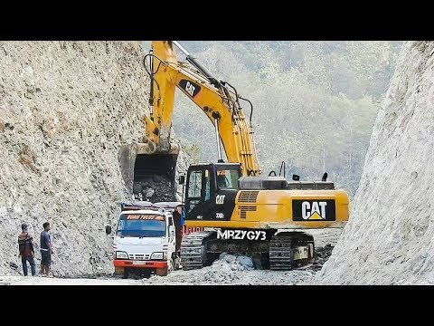 Heavy Equipment Excavator Dump Trucks Work On Road Construction