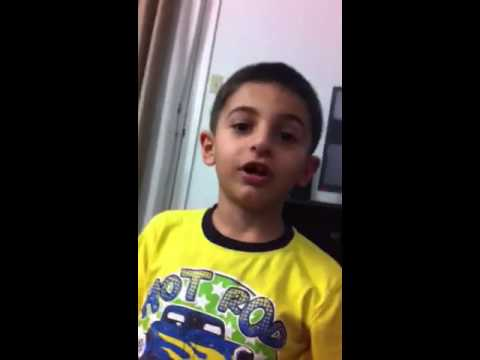 Akkad Zaya  7 years old TV remote control  magic ,, Assyrian language.